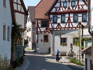 Riding through the pretty wine-growing village Erlabrunn